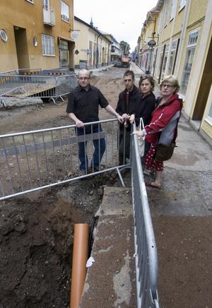 Förlust. Jason Holifield, Annicka Skoglund, Charlotte Swartling och Per Sundkvist är alla ägare till butiker på Slaggatan som tappat i omsättning.