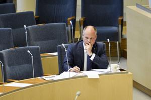 Justitie- och migrationsminister Morgan Johansson (S) under en debatt  i riksdagen.