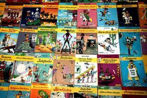 Några exempel av de cirka 40 Lucky Luke-album som Kåre Persson har översatt.
