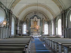 Hedesunda kyrka i nutid, utan altartavlan. Foto: Wikipedia/Ulf Klingström.