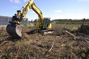 Den äkte grävmaskinistens precision är en förebild för framtidsbygget.