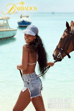 Bild ur kampanjen för Barbados: Fiskebåtar och Rihanna vid Six Mens Bay.