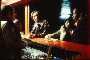 Don Tonay (Peter Kay), Tony Wilson (Steve Coogan), Lindsay Wilson (Shirley Henderson) och  Alan Erasmus (Lennie James) i Michael Winterbottoms film