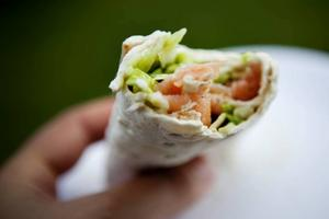 Tradition. Lax-rullen är en viktig del av den årliga traditionen på Harkskärsdagen. Den innehåller lax, grönsaker och tunna bröd. Den serveras med en dricka för bara 30 kronor.
