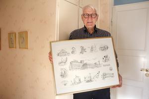 Sven Vesterlund med en tavla som Bo Svärd tecknat inför företagets 100-årsjubileum 1989.