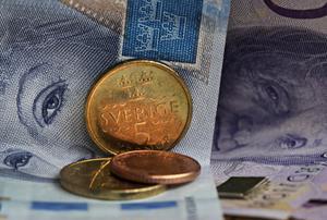 Sedlar och mynt, drygt 130 kronor. Foto: Fotograferna Holmberg / TT.