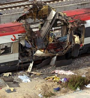 A body of a dead passenger lies next to a damaged train car in Atocha train station in Madrid, Thursday March 11, 2004 after bombs rocked trains in three train stations in Madrid killing at least 190 rush-hour commuters and injuring more than 1,240. (AP Photo/EFE, J.J. Guillen) ** SPAIN OUT **