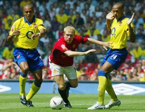 Paul Scholes var en briljant passningspelare för sitt Manchester United. Här i en match mot Arsenal.