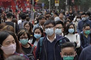 Ansltuningen till flera kinesiska städer har stoppats för att förhindra spridning av sjukdomen. Foto: Kin Cheung/AP