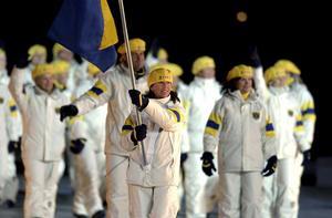 Magdalena Forsberg var fanbärare vid invigningen i Salt Lake City 2002. Bild: Claudio Bresciani/TT.