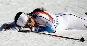 Charlotte Kalla efter målgång på 10 kilometer klassiskt i Sotji. Bild: AP Photo/Gregorio Borgia)