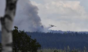 Vattenbombning av skjutfältsbranden i Trängslet 24:e juli.