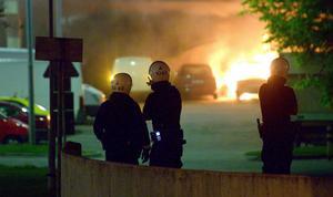 Polis på plats vid kravallerna i Husby 2013. Foto: Johan Nilsson/TT
