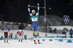 Stina Nilsson, lika överlägsen som historisk i OS-spåren. Foto: Kirsty Wigglesworth/AP