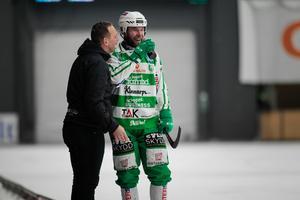 Anders Bruun och tränaren Michael Carlsson.