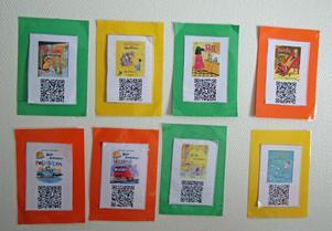 Med hjälp fritidshemmens läsplattor kan eleverna skanna en QR-kod och på så sätt enkelt få den bok de vill läsa nedladdad.