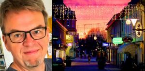 Vinnaren med sin bild över Rådmansgatan. Foto: Anders Sjöqvist