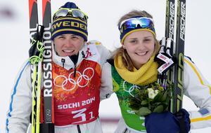Ida Ingemarsdotter och Stina Nilsson efter OS-bronset i Sotji.  Foto: Matthias Schrader/AP