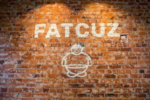 Restaurangens logga, som föreställer en fet kusin.