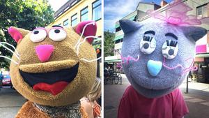 Två glada katter: Festivalens maskot Tasse och nytillskottet Kattis.