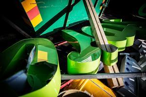 Stenar och bråte från en container har används för att förstöra de dyra och specialtillverkade neonskyltarna.