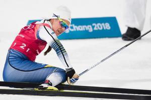 Anna Haag pustar ut efter sin förstasträcka i damernas stafett. Bild: Petter Arvidson/Bildbyrån.