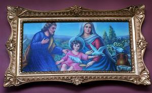 Jesusbarnet med Josef och Maria på en målning i Alsike kloster i Uppsala.