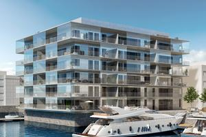 Högst upp i Kajhuset, med utsikt över vattnet och mot Sundsvallsbron, ligger den 162 kvadratmeter stora lägenheten.