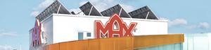 Utmanaren. Max hamburgerrestaurang av den typ som ska byggas i Köping. Solpaneler och grästak hör till den ekologiska profilen.
