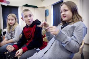 Emma, Alex och Liv har olika uppgifter i orkestern.