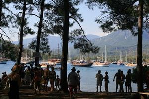 Phaselis med turister och Gületbåtar.