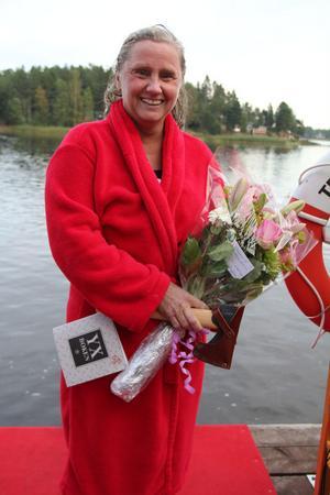 En trött - men glad och nöjd - simmerska på bryggan i Mellanfjärden