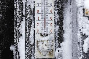 A thermometer covered in ice shows the temperature near Destne v Orlickych Horach, Czech Republic, Monday, Jan. 9, 2017. The Czech Republic has been hit by a freezing weather in recent days with the temperature dropping as low as minus 34.6 degrees Celsius (-30 F) on Saturday in the Sumava mountain range near the border with Germany. (AP Photo/Petr David Josek)