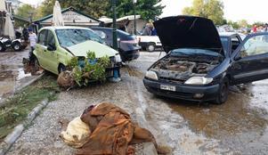 Bilar och bråte har vräkts huller om buller av en flodvåg som sköljt genom samhället.