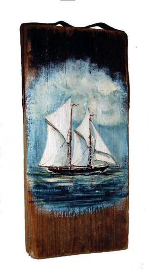 Gösta Brandt målar båtar med svällande segel.
