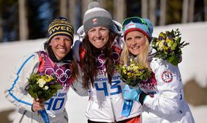Pallen med silvermedaljören Charlotte Kalla, guldmedaljören Justyna Kowalczyk och bronsmedaljören Therese Johaug.
