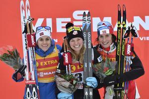 Heidi Weng, Jessica Diggins and Marit Björgen på podiet efter damernas 5 km.