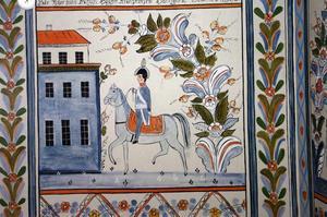 Ridande kung. Kung Karl Johan finns med på några av väggmålningarna.