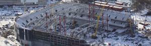 Flygbild över den nya nationalarenan i Solna, som byggs för full med betongprodukter som tillverkas i Kungsör.
