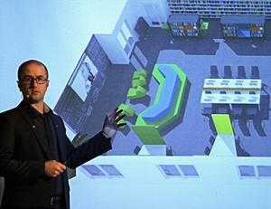 Peyman Vahedi vid en skiss av det makerspace som ska byggas på skolan.