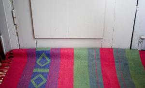 En hoprullad matta framför en dragig dörr ger skönare miljö i huset, och spar en slant.