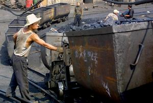 Gruvarbetare på en kolgrunva i kinesisak Datong.