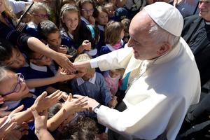 Pope Francis meets school children in the village of Arquata del Tronto, Italy, Tuesday, Oct. 4, 2016. Francis had made clear his intentions to visit the August quake-stricken zone in central Italy, but without announcing a date, indicating that he wanted to go alone