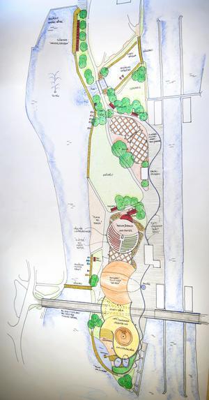 Så här kan Slussholmen se ut i framtiden om Liberalerna får bestämma. I nederkant ses kanalen med slussen och den blå randen som slingrar sig fram är blå stenplattor i underlaget för att förstärka kopplingen till vatten. Här ses ett nytt badhus och en fyr till vänster, därefter biografen och amfiteatern med de grön-röda läktarna som ska påminna om ett sjömärke. I mitten ses