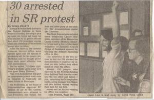 Owen Laws på bild i en tidningsartikel från början av 1980-talets Kalifornien.Tillsammans med hundratalet universitetsstudenter blockerade han ett skattekontor. Orsaken var att USA, för tillfället, skänkte pengar till rebellgrupper i Nicaragua.