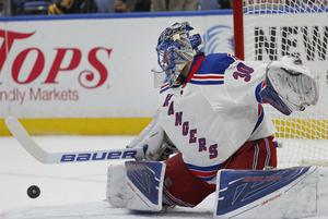New York Rangers goalie Henrik Lundqvist (30) makes a pad save during the first period of an NHL hockey game against the Buffalo Sabres, Thursday, Dec. 1, 2016, in Buffalo, N.Y. (AP Photo/Jeffrey T. Barnes)