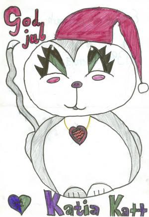 God jul, säger den tjusiga Katia Katt i tomteluva. Bilden är tecknad av Emilia Bygdemark i Sidensjö.