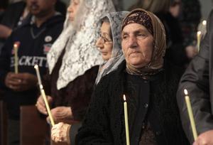 Kristna flyktingar håller gudstjänst i Amman i Jordanien.