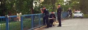 Polisen på plats vid Emausmotet vid E 18.