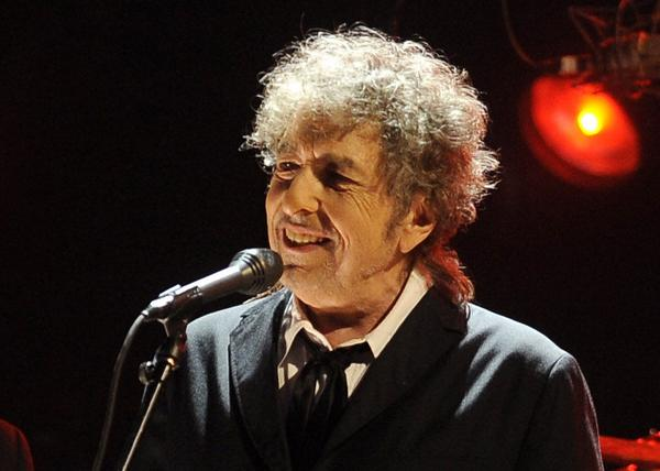 FILE - In this Jan. 12, 2012 file photo, Bob Dylan performs in Los Angeles. Fifty years into his career as a recording artist and a week away from release of an extraordinary new CD, Dylan spent his Tuesday evening where he seems to feel most comfortable ó on a stage. (AP Photo/Chris Pizzello, File)